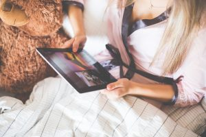 beautiful-girl-holding-an-ipad-in-bed-picjumbo-com